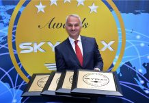 Turkish Airlines CEO Mr, Temel Kotil holding the award