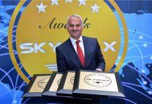 Turkish Airlines CEO Mr, Temel Kotil holding the award