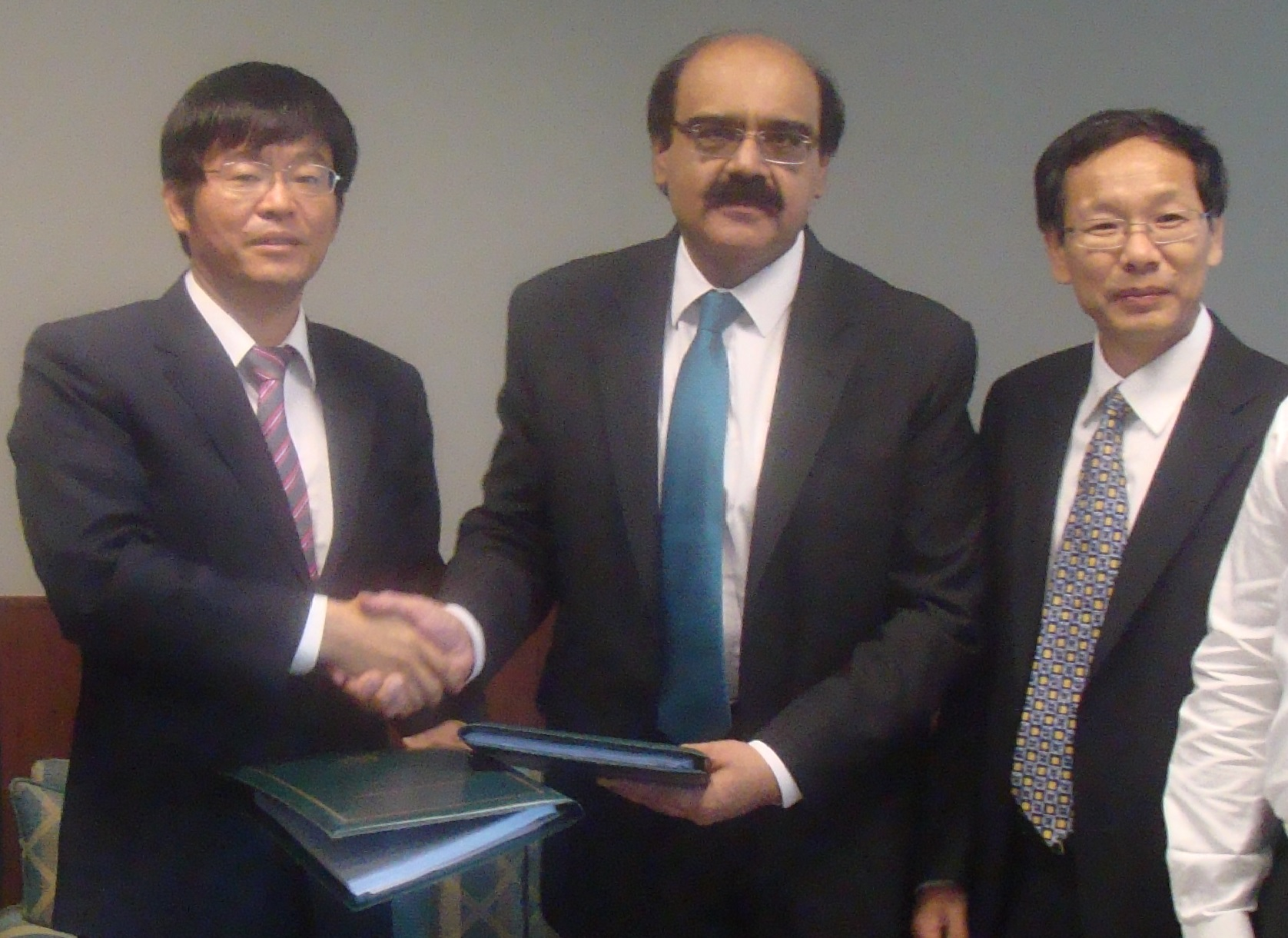 Exchanging documents after Sigining of IA of 720MW Karot Hydro Power Project